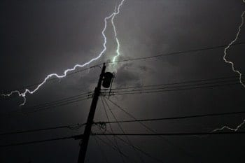 Mister Sparky Electrician Kansas City advises using a surge protector to stay safe from bad weather.